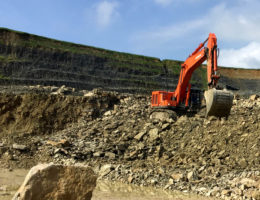 Earth movers excavating mine site